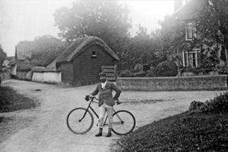 Baker Street, looking east - thatched cottages, now Chequers garage
